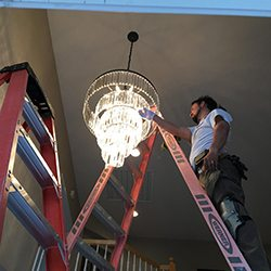 electrical contractor repairing residential home lighting